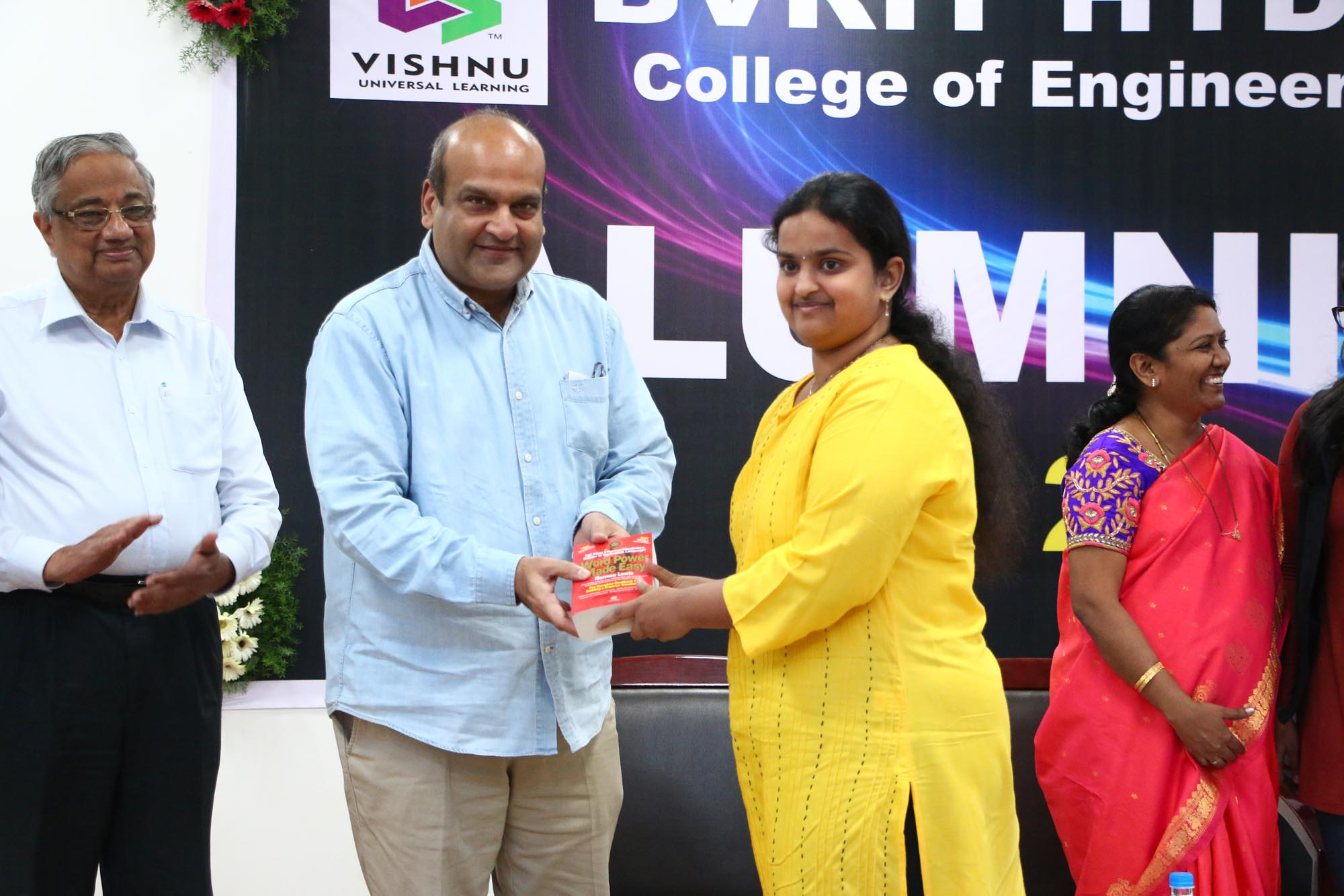 Chairman presenting - appreciation gift to Alumni Student